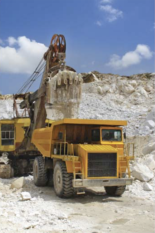 Surface shovel (Foreign Trade, 2018.01).png. A shovel and mine dump truck excavating ore, reportedly in the area of the Ryongyang Mine.