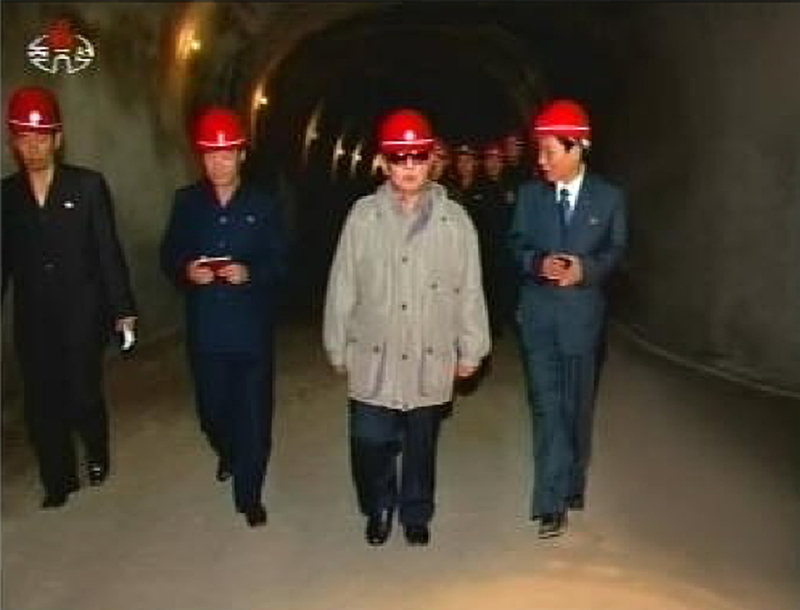 Kim Jong-il in Ryongyang Mine (KCTV, 2009.05.21).png. Kim Jong-il visiting the Ryongyang Mine.