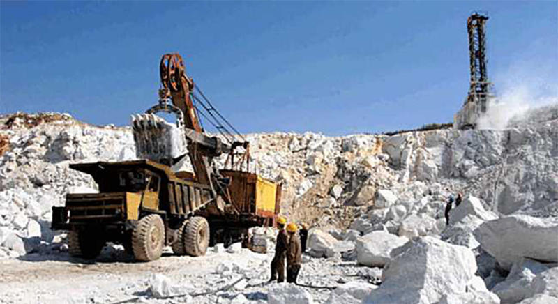 A large ore haul truck being loaded by a shovel at the Taehung Youth Hero Mine. (Naenara, April 12, 2013)